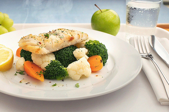 White fish fillet served with steamed veg